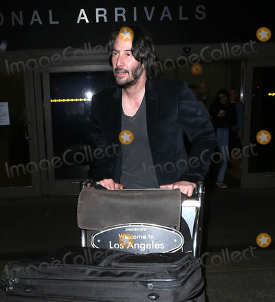 Photos From Keanu Reeves is seen at LAX Airport in Los Angeles, CA