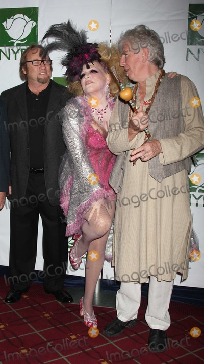 Bette Midler Photo - Crosby Stills Nash Midler8425JPGNYC  103009Bette Midler (dressed as a Showghoul) with David Crosby Stephen Stills and Graham Nash at Bette Midlers annual HULAWEEN Gala supporting New York Restoration Project at the Waldorf AstoriaDigital Photo by Adam Nemser-PHOTOlinknet