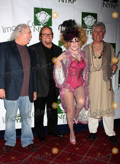 Bette Midler Photo - Crosby Stills Nash Midler8432JPGNYC  103009Bette Midler (dressed as a Showghoul) with David Crosby Stephen Stills and Graham Nash at Bette Midlers annual HULAWEEN Gala supporting New York Restoration Project at the Waldorf AstoriaDigital Photo by Adam Nemser-PHOTOlinknet