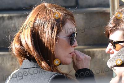 Philip Seymour Hoffman Photo - February 7 2014 New York CityJulianne Moore attending Philip Seymour Hoffmans funeral at St Ignatius Loyola Church in Manhattan on February 7 2014 in New York City