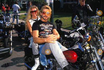 John Schneider Photo - -1987 John Schneider and Kodua Michele Photo by Michelson-Globe Photos