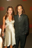 Kenny G Photo - Kenny G and wife At the The Louis Vuitton United Cancer Front Gala Universal Studios Universal City CA 11-08-04