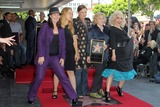Kathy Valentine Photo - Kathy Valentine Charlotte Caffey Belinda Carlisle Gina Schock and Jane Wiedlinat the Go-Gos induction into the Hollywood Walk of Fame Hollywood CA 08-11-11