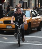 Mingus Reedus  Photo - NYC  043010Norman Reedus with his son Mingus Reedus (his mother is Helena Christensen) standing on the back of his bicycle while riding around in SOHODigital Photo by Adam Nemser-PHOTOlinknet