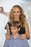 Kim Raver Photo - Kim Raver  son at the Los Angeles premiere of 42 The True Story of An American Legend at the Chinese Theatre HollywoodApril 9 2013  Los Angeles CAPicture Paul Smith  Featureflash