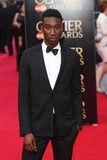 Nathan Stewart-Jarrett Photo - Nathan Stewart-Jarrett arrives for the Laurence Olivier Awards 2014 at the Royal Opera House Covent Garden London 13042014 Picture by Henry Harris  Featureflash