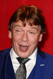 Adam Woodyatt Photo - Adam Woodyatt arriving for the 2014 British Soap Awards at the Hackney Empire London 24052014 Picture by Steve Vas  Featureflash