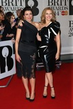Dannii Minogue Photo - Kylie and Dannii Minogue arriving at The Brit Awards (Brits) 2014 held at the O2 London 19022019 Picture by Henry Harris  Featureflash