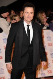 Donny Osmond Photo - Donny Osmond arriving for the National Television Awards 2013 at the O2 Arena London 23012013 Picture by Steve Vas  Featureflash