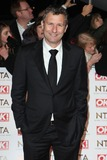 Adam Hills Photo - Adam Hills arriving for the 2015 National Television Awards (NTAs) at the O2 London 21012015 Picture by Alexandra Glen  Featureflash
