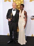 Lupita Nyongo Photo - Lupita Nyongo  JK Simmons at the 87th Annual Academy Awards at the Dolby Theatre HollywoodFebruary 22 2015  Los Angeles CAPicture Paul Smith  Featureflash