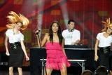 Anggun Photo - Dj Laurent Wolf (Center Behind) and Singer Anggun (in Pink) Performing at the World Music Awards at Sporting Club in Monte Carlo Monaco on November 9th 2008 Photo by Alec Michael-Globe Photos