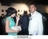BILLY  ZANE Photo -  Photo Art in Memory of Davide Sorranti at Milk Studios NYC 09192000 Milla Jovovich and Billy Zane Photo by Rose HartmanGlobe Photosinc
