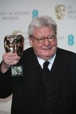Alan Parker Photo - Director Alan Parker Poses in the Press Room of the Ee British Academy Film Awards at the Royal Opera House in London England on 10 February 2013 Photo Alec Michael Photo by Alec Michael- Globe Photos Inc