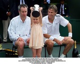 Bjorn Borg Photo - Alpha Globe Photos Incm041288 02072000 London John Mcenroe Daughter Four Year Old Anna Mcenroe Holds Her Fathers Trophy For Winning a Charty Match Against Bjorn Borg (R) -Nspcc Childrens Charity Tennis Match at Buckingham Palace  London