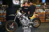 Mike Metzger Photo - MIKE METZGER AND CALEB WYATTFREESTYLE MOTOCROSS SUPER HEROES MIKE METZGER AND CALEB WYATT SIGN AUTOGRAPHS FOR THE RELEASE OF THEIR ACTION PACKED STORY BEHIND THE ULITMATE FREESTYLE MOTOCROSS MANEUVER ENTITLED FLIPPED OUT -TOWER RECORDS WEST HOLLYWOOD CA -08122003 -PHOTO BY NINA PROMMERGLOBE PHOTOS INC2003 K32183NP