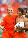 Arjen Robben Photo - Arjen Robben  Van Bronckhorst Cellebrate Win Holland V Ivory Coast World Cup Soccer 06-16-2006 Photo by Allstar-Globe Photos