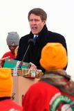 JFK Photo - 121002_Queens NY_Rocker US Senator Bill Frist (L) evangelist Franklin Graham (son of Rev Billy Graham) (R) and hundreds of kids in Operation Christmas Child for kids suffering from HIVAids in Uganda  Sudan with 80000 Xmas gifts packed in shoeboxes Gifts were loaded at JFK Airport on the Antonov 225PHOTO BYNeil SchneiderGLOBE PHOTOS INC 2002 K28008NS