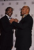 George Foreman Photo - Evander Holyfield with George Foreman L2505 Photo by Adam Scull-Globe Photos Inc
