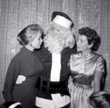 Rock Hudson Photo - Rock Hudson As Santa at Hollywood Womens Press Club with Janet Leigh Deborah Kerr Photo Globe Photos Inc