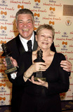 Judi Dench Photo - Dave BenettalphaGlobe Photos Inc 054173 02202004 Matthew Kelly (Best Actor Winner) and Dame Judi Dench Winner of the Special Award Presented by Kevin Spacey -the Laurence Olivier Theatre Awards at the Hilton Park Lane London