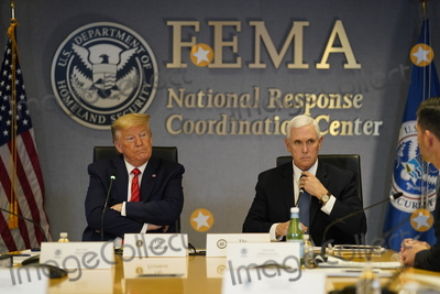 Photo - President Donald Trump and Vice President Mike Pence visit the Federal Emergency Management Agency headquarters