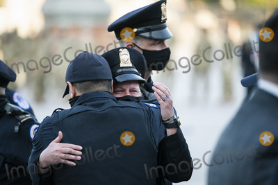 Photo - WASHINGTON DC - APRIL 13 United States Capitol Police officers embrace after the casket of fellow US Capitol Police Officer William Billy Evans departed after laying in Honor on Capitol Hill on Tuesday April 13 2021 in Washington DCCredit Jabin Botsford  Pool via CNPAdMedia