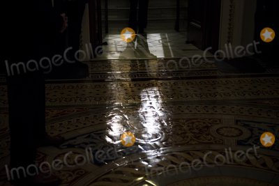 Photos From United States Senate Majority Leader Mitch McConnell (Republican of Kentucky) walks from the Senate chamber to his office at the US Capitol during a vote.