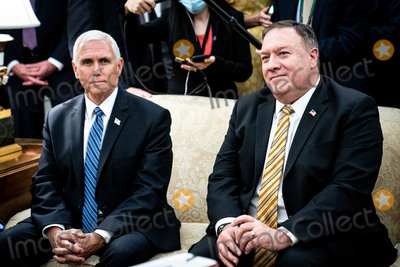Photo - United States Vice President Mike Pence and US Secretary of State Mike Pompeo look on as US President Donald J Trump and Polish PresidentAndrzej Duda confer during a bilateral meeting in the Oval Office of the White House in Washington DC on June 24 2020 Credit Erin Schaff  Pool via CNPAdMedia