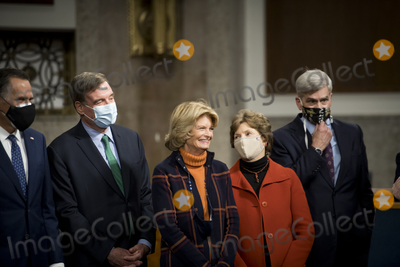 Alaska  Photo - United States Senator Mitt Romney (Republican of Utah) left US Senator Mark Warner (Democrat of Virginia) second from left US Senator Lisa Murkowski (Republican of Alaska) third from left US Senator Jeanne Shaheen (Democrat of New Hampshire) second from right and US Senator Bill Cassidy (Republican of Louisiana) right join United States Senator Joe Manchin III (Democrat of West Virginia) and a bipartisan group of US Senators announcing the legislative text of the two bipartisan bicameral COVID-19 emergency relief bills that propose to provide up to 908 billion in emergency relief in the Dirksen Senate Office Building on Capitol Hill in Washington DC on Monday December 14 2020 The first will allocate 748 billion for more PPP assistance and an unemployment benefit and a second 160 billion bill to provide aid for state and local governments and liability protections for businessesCredit Rod Lamkey  CNP