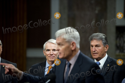 Photo - United States Senator Rob Portman (Republican of Ohio) left and United States Senator Joe Manchin III (Democrat of West Virginia) right listen while United States Senator Bill Cassidy (Republican of Louisiana) center makes remarks after the vote on the motion to invoke cloture to proceed to the consideration of HR 3684 the INVEST in America Act on Capitol Hill in Washington DC on Wednesday July 28 2021 The vote to begin discussion of the bipartisan infrastructure bill agreed to by the White House was 67 to 32 If passed the bill would invest close to 1 trillion in roads bridges ports and other infrastructure without a major tax increaseCredit Rod Lamkey  CNPAdMedia
