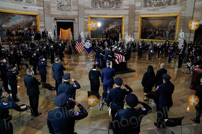 Photo - Members of US Capitol Police salute the body of their colleague US Capitol Police officer William Evans at the Capitol Hill in Washington on Tuesday April 13 2021Credit Amr Alfiky  Pool via CNPAdMedia