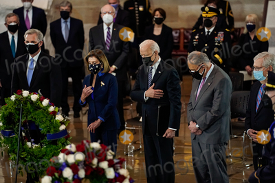 Photo - United States President Joseph R Biden Jr attends a lying in honor ceremony for US Capitol Police officer William Billy Evans on the Capitol Hill in Washington on Tuesday April 13 2021  From left to right US House Minority Leader Kevin McCarthy (Republican of California) Speaker of the US House of Representatives Nancy Pelosi (Democrat of California) President Biden US Senate Majority Leader Chuck Schumer (Democrat of New York) and US Senate Minority Leader Mitch McConnell (Republican of Kentucky)Credit Amr Alfiky  Pool via CNPAdMedia