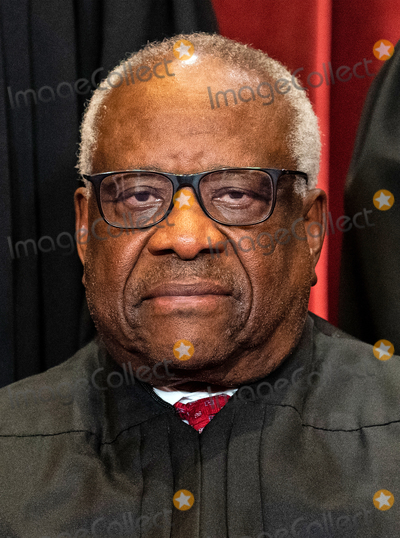 Supremes Photo - Associate Justice of the Supreme Court Clarence Thomas sits during a group photo of the Justices at the Supreme Court in Washington DC on April 23 2021 Credit Erin Schaff  Pool via CNPAdMedia