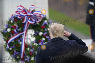 Photo - United States President Donald J Trump and First lady Melania Trump participate in a  National Veterans Day Observance