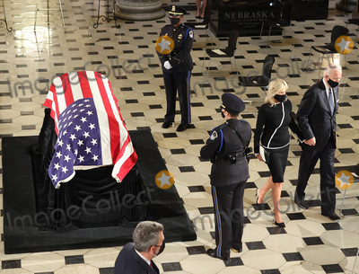 American Flag Photo - Democratic Presidential nominee former United States Vice President Joe Biden and his wife Dr Jill Biden walk away after paying their respects in front of the American flag draped casket of US Supreme Court Associate Justice Ruth Bader Ginsburg as she lies in state at the US Capitol on September 25 2020 in Washington DC Ginsburg who was appointed by former US President Bill Clinton served on the high court from 1993 until her death on September 18 2020 She is the first woman to lie in state at the Capitol Credit Chip Somodevilla  Pool via CNPAdMedia