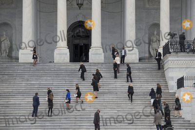 Photo - Members of Congress arrive on the East Front Steps of the US Capitol as the casket carrying Supreme Court Justice Ruth Bader Ginsburg departs the US Capitol in Washington DC Friday September 25 2020 after lying in state in Statuary Hall Justice Ginsburg died from her battle with pancreatic cancer and is the first woman to lie in state at the US Capitol Credit Rod Lamkey  CNPAdMedia