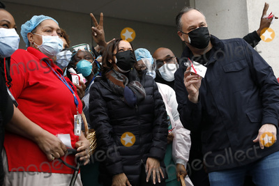 Group Photo Photo - US Vice President Kamala Harris (C) and second gentleman Doug Emhoff pose for a group photo with health care workers as they visit the VA Center a veterans hospital in Washington on February 13 2021Credit Yuri Gripas  Pool via CNPAdMedia