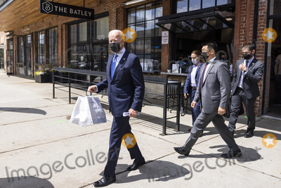 Joe Biden Photo - United States President Joe Biden departs after picking up tacos during a visit to Las Gemelas Restaurant  in Washington DC USA 05 May 2021United States President Joe Biden picks up tacos during a visit to Las Gemelas Restaurant  in Union Market to highlight the successes of the American Rescue Plan (ARP) in Washington DC USA 05 May 2021  Las Gemelas is a beneficiary of relief funding from the pilot program Restaurant Revitalization Fund  The ARPs Restaurant Revitalization Fund provides 286 billion in direct relief to restaurants and food and beverage establishments and prioritizes restaurants that are women-owned veteran-owned and owned by other socially and economically disadvantaged individualsCredit Jim LoScalzo  Pool via CNPAdMedia