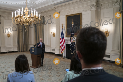 Photo - United States President Joe Biden takes questions after delivering remarks on the Covid-19 response and the vaccination program from the State Dining Room of the White House in Washington DC on Tuesday May 4 2021  The President announced he will allow some governors to turn down doses they dont need or want and reallocate those doses to other states and he also set a goal of getting at least one dose of the Covid-19 vaccine to 70 percent of adults by July 4Credit Alex Edelman  Pool via CNPAdMedia