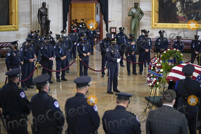 Photo - WASHINGTON DC - APRIL 13 A large group of Capitol Police officers surround the casket of the late US Capitol Police officer William Billy Evans during a memorial service as Evans lies in honor in the Rotunda at the US Capitol on April 13 2021 in Washington DC Officer Evans was killed in the line of duty during the attack outside the US Capitol on April 2 He is thesixthCapitol Police officer to die in the line of duty in the nearly 200 years since the force was createdCredit Drew Angerer  Pool via CNPAdMedia