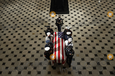 Photo - A US military carry team moves US Supreme Court Associate Justice Ruth Bader Ginsburgs flag-draped casket out of Statuary Hall after she layed in state at the US Capitol on September 25 2020 in Washington DC Ginsburg who was appointed by former US President Bill Clinton served on the high court from 1993 until her death on September 18 2020 She is the first woman to lie in state at the Capitol Credit Chip Somodevilla  Pool via CNPAdMedia
