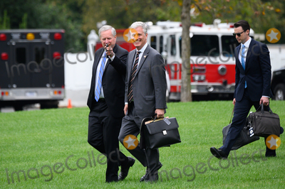 Photo - Mark Meadows Assistant to the President and Chief of Staff and United States National Security Advisor Robert C OBrien walk on the South Lawn of the White House before boarding Marine One in Washington DC US on Thursday September 24 2020 Credit Erin Scott  Pool via CNPAdMedia