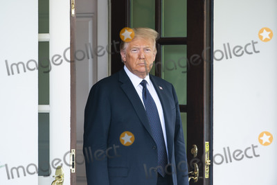 Photo - US President Donald J Trump waits to welcome Polish President Andrzej Duda (not pictured) to the White House in Washington DC USA 24 June 2020 Duda a conservative nationalist facing a tight re-election back home is the first foreign leader to visit the White House in more than three monthsCredit Jim LoScalzo  Pool via CNPAdMedia