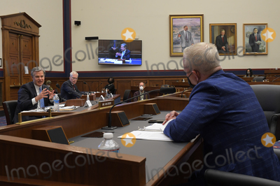 Photo - FBI director Christopher Wray left  testifies before United States Representative Jefferson Van Drew (Republican of New Jersey) right at the US House Committee on Homeland Security in Washington DC  on September 17 2020 Credit John McDonnell   Pool via CNPAdMedia