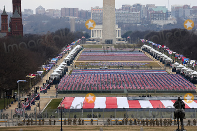 American Flag Photo - WASHINGTON DC - JANUARY 20  Members of the National Guard look on as American flags decorate the Field of Flags at the National Mall during the inauguration of US President-elect Joe Biden on the West Front of the US Capitol on January 20 2021 in Washington DC  During todays inauguration ceremony Joe Biden becomes the 46th president of the United States (Photo by Tasos KatopodisGetty Images)AdMedia