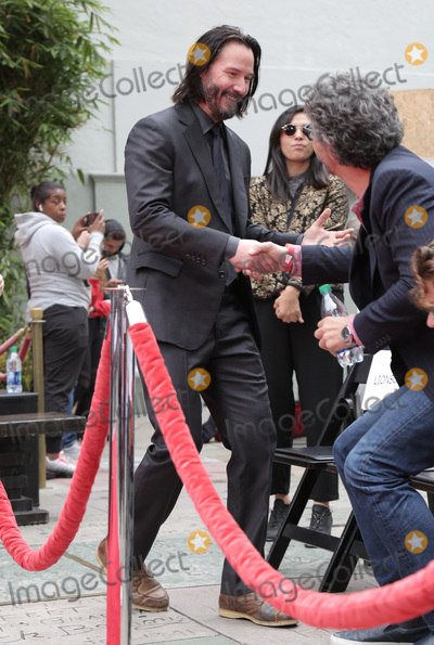 Photos From Keanu Reeves Places His Hand Prints In Cement