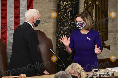 Photo - US House Speaker Nancy Pelosi a Democrat from California right and US Vice President Mike Pence wear protective masks while speaking during a joint session of Congress to count the Electoral College votes of the 2020 presidential election in the House Chamber in Washington DC US on Wednesday Jan 6 2021 Congress is meeting to certify Joe Biden as the winner of the 2020 presidential election with scores of Republican lawmakers preparing to challenge the tally in a number of states during what is normally a largely ceremonial event Credit Erin Scott  Pool via CNPAdMedia