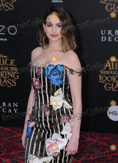 Photo - 24 May 2016 - Hollywood California - Anne Hathaway Arrivals for the Premiere Of Disneys Alice Through The Looking Glass held at El Capitan Theater Photo Credit Birdie ThompsonAdMedia