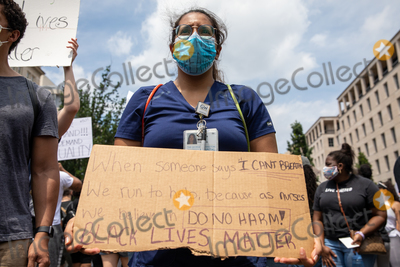 Photo - Giannina Findlay an emergency room nurse at George Washington University holds up a protest sign during a march against police brutality and racism in Washington DC on Saturday June 6 2020Credit Amanda Andrade-Rhoades  CNPAdMedia